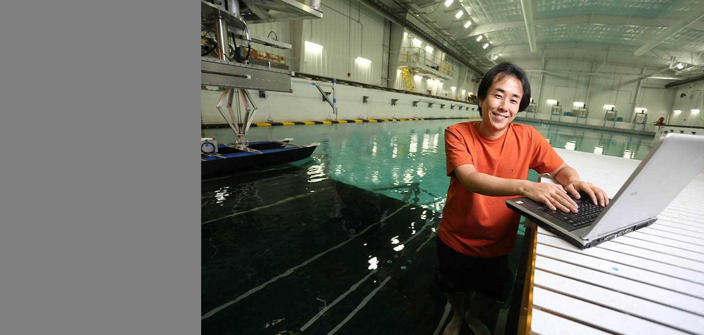IIHR's Yugo Sanada at the wave basin. He is developing a new technique that uses reflected light to better visualize the water's surface.
