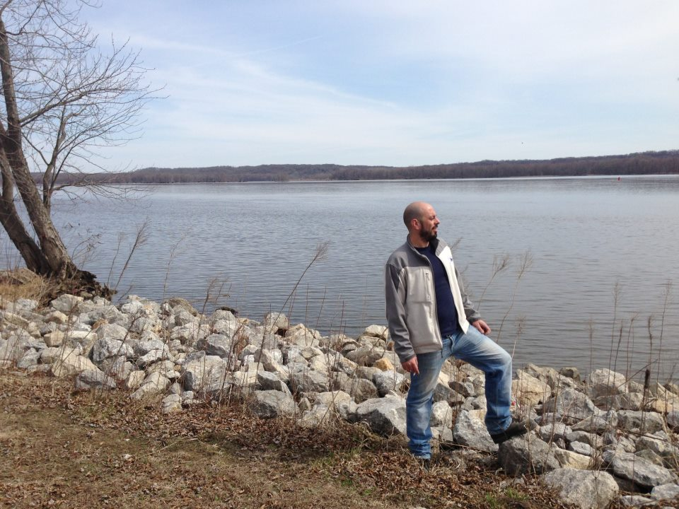 Researcher on the bank of the Mississippi River.