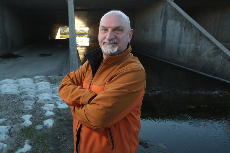 Marian Muste in the self-cleaning culvert.