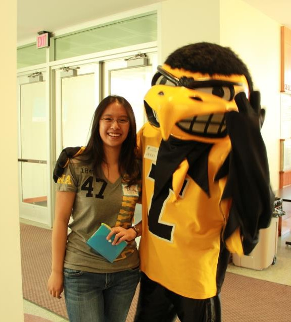 Su poses with Herky in the Seamans Center, where she spend most of her time at the university.