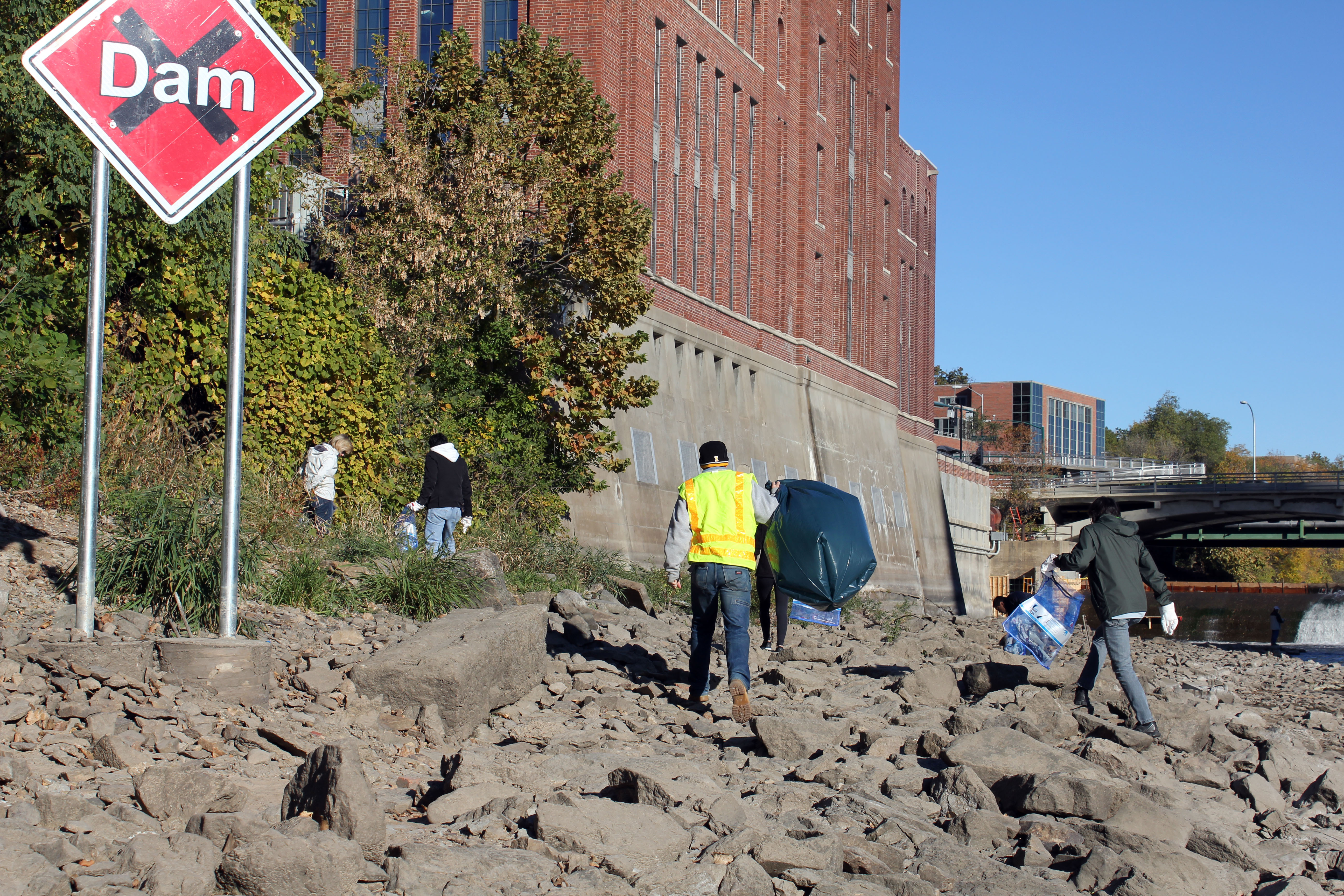 Volunteers help clean up the Iowa River.