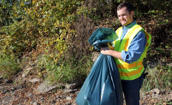 Student helps clean up the river.
