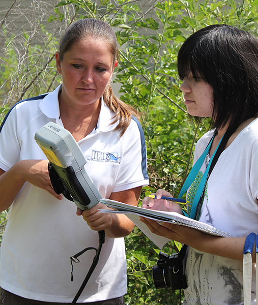 IIHR Assistant Research Scientist Carrie Davis shows a student how to use a water-quality sensor.
