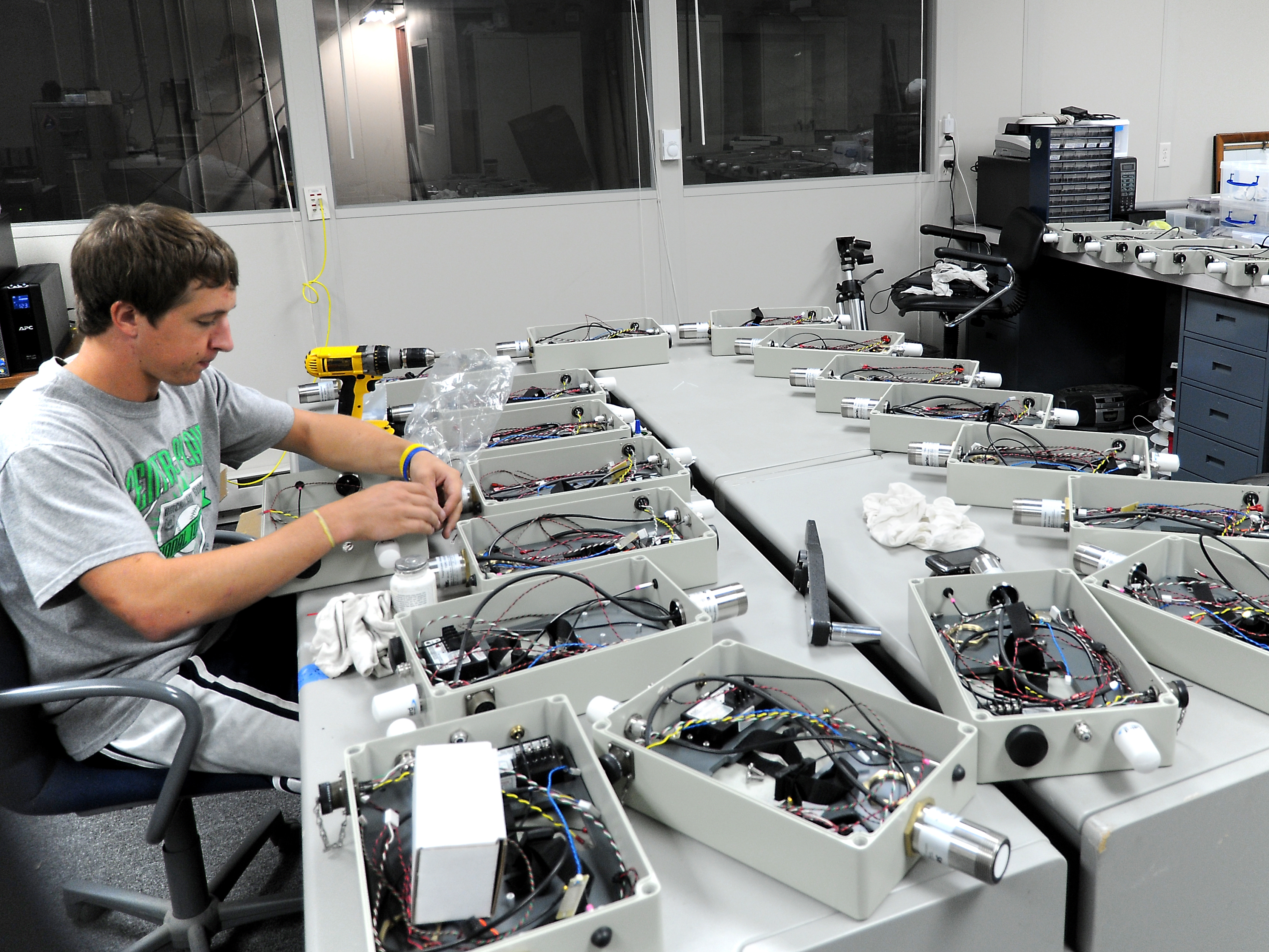 A researcher works on a stream stage sensor.