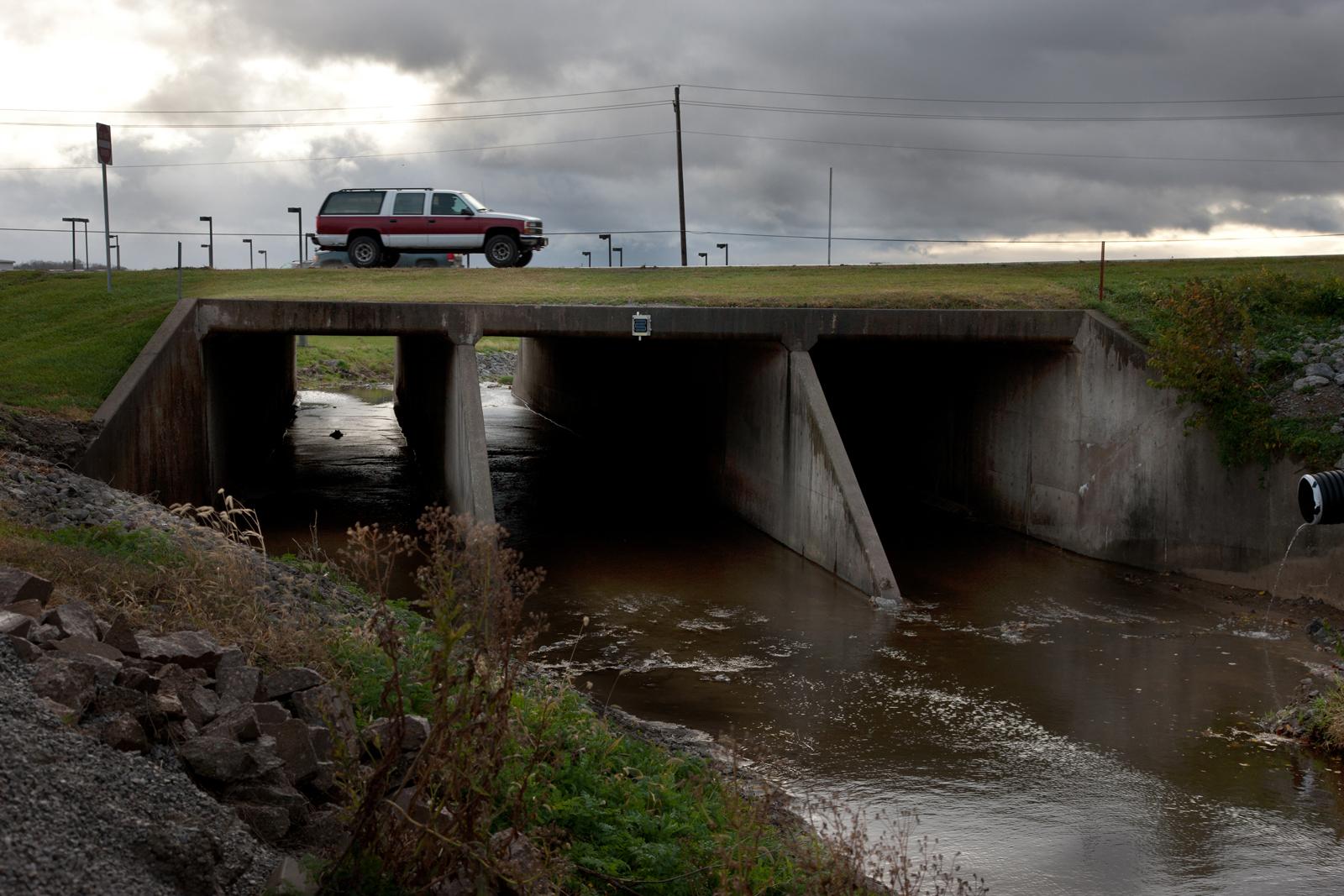 A SUV parked on a bridge.