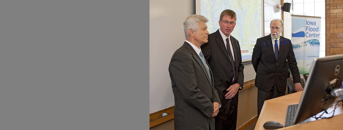 Iowa Flood Center Director Witold Krajewski, Congressman David Loebsack, and IIHR Director Larry Weber giving a presentation.