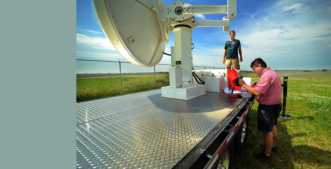 IIHR researchers working on a radar.