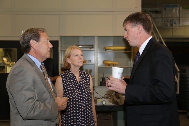 IIHR Director and IFC co-founder Larry Weber (right) talks with UI President Bruce Harreld and Mary Harreld at the IFC open house.