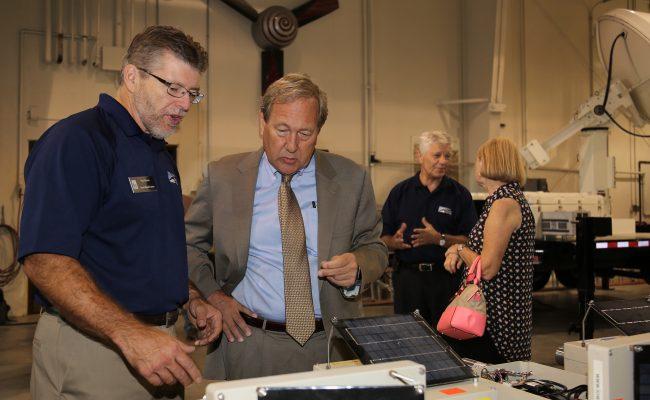 The IFC's Dan Ceynar (left) explains to UI President Bruce Harreld how the center's stream-stage sensors work.