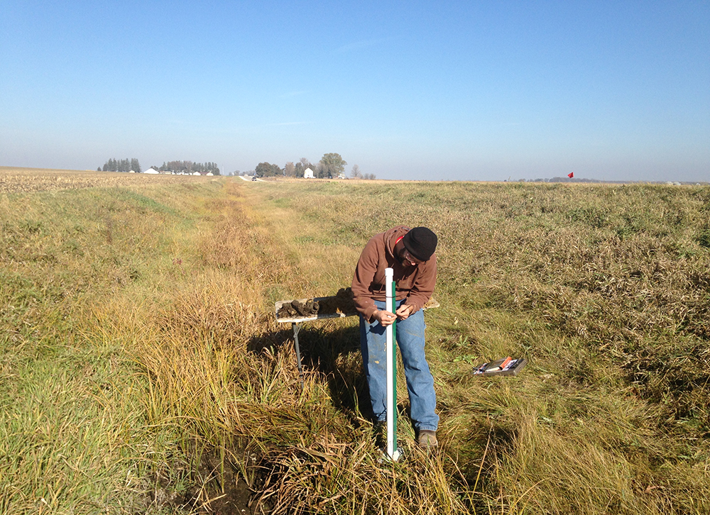 IGS soil scientist Matthew Streeter works in one of the roadside ditches in Buchanan County.