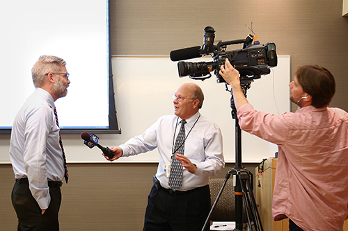 IFC Associate Director Nathan Young (left) speaks with the media about the completion of the floodplain mapping project.