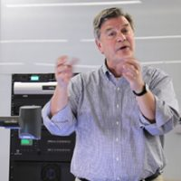 Jerry Schnoor speaks in front of an audience about climate change.