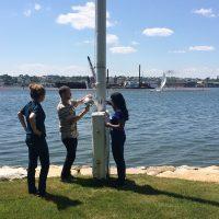 IIHR's Andres Martinez (center) adjusts a sensor measuring airborne PCBs near the New Bedford Harbor in Massachusetts.