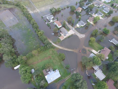 This is an aerial photo taken by a drone of flooding that occurred in September 2016 in Eastern Iowa. Homes and streets are partially underwater.