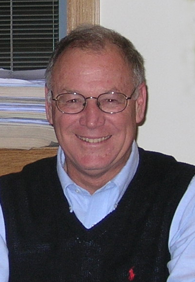 Headshot of Forrest Holly in his home.