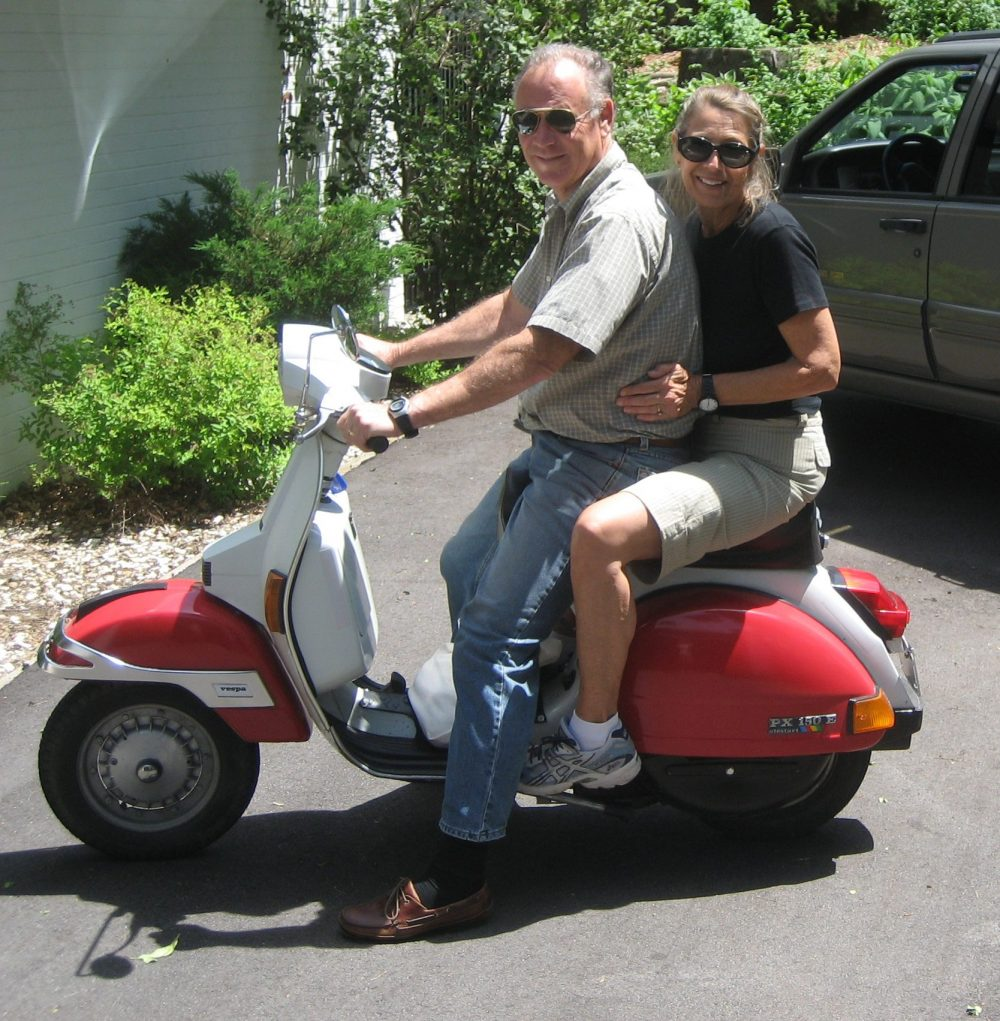 Forrest Holly and wife Joyce on their Vespa.