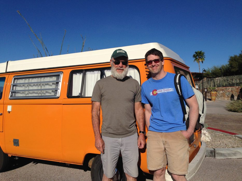 Forrest Holly (left) in front of his VW bus.