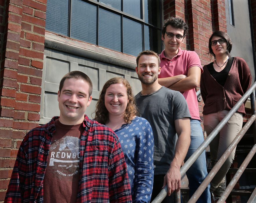 Five students on the fire escape outside Stanley Hydraulics Lab.