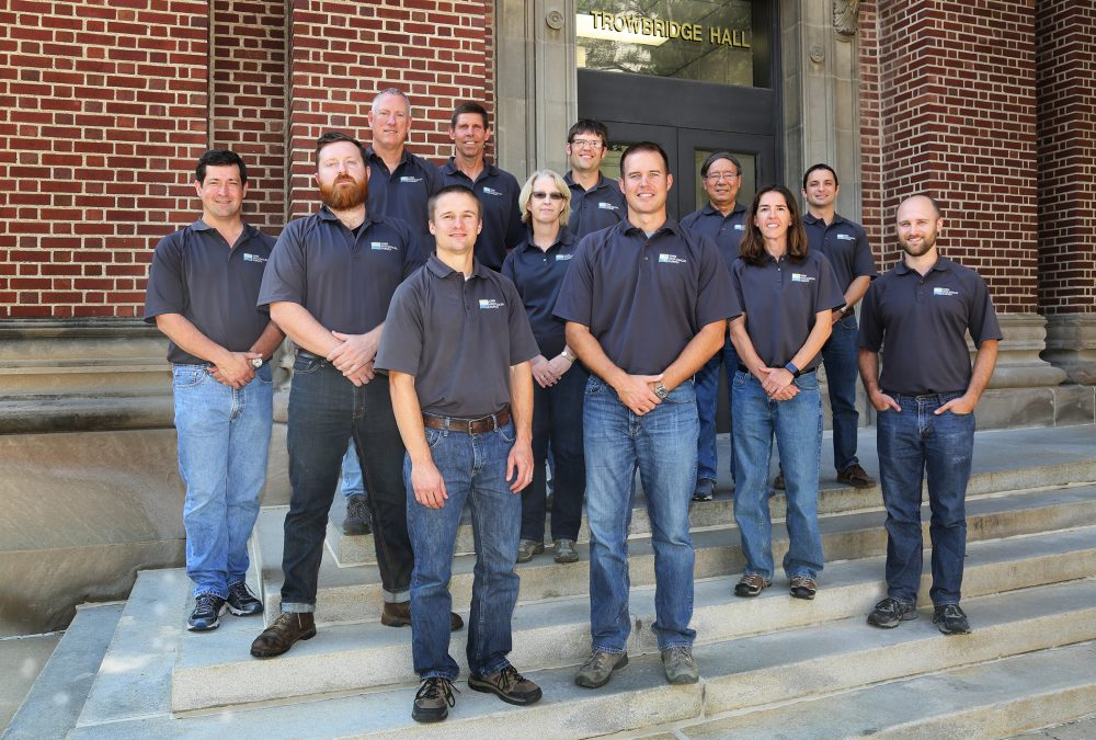 A group of people, the staff of the Iowa Geological Survey, on the steps of Trowbridge Hall.