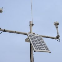 A close-up photo of the hydrologic instruments deployed on a tripod.