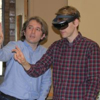 A reporter from the Cedar Rapids Gazette tries out the AI goggles with help from