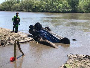 The dive team next to the retrieved car.