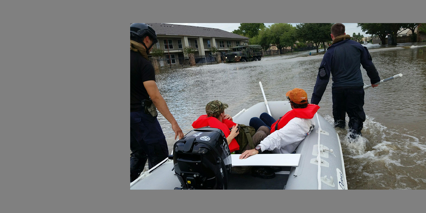 Officials rescue flood victims in an inflatable boat after Hurricane Harvey.