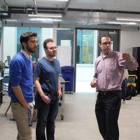 James Buchholz guides students through the Fluids Lab.