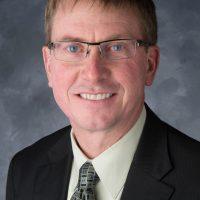 Formal headshot of Larry Weber