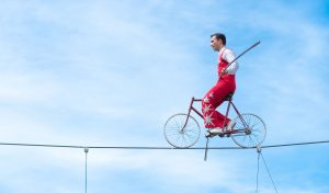 Tino Wallenda Rides across a high wire on his bike