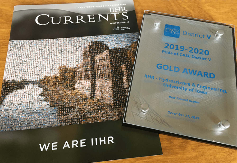A magazine cover and a silver and blue award plaque