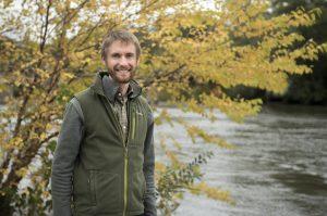 Greg LeFevre stands in front of a pond
